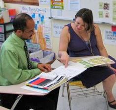 Facilitator training a teacher