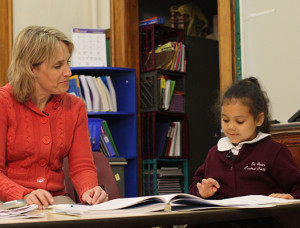 Teacher with student reading