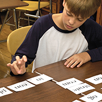 Boy tapping out syllables