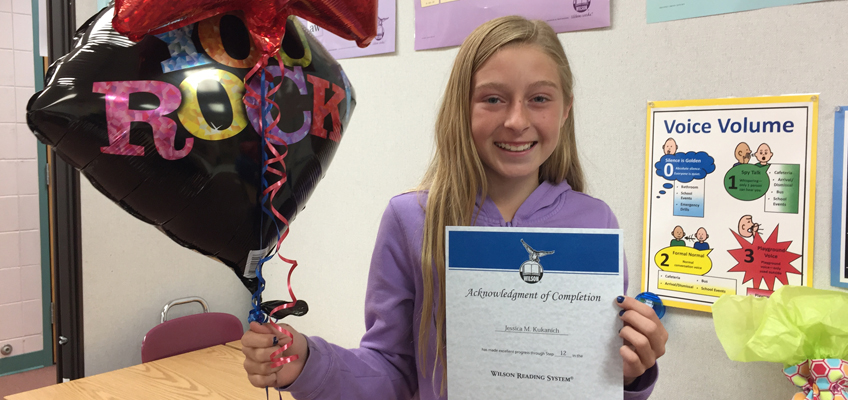 Fifth grader Jessica K. celebrates completing WRS Step 12.