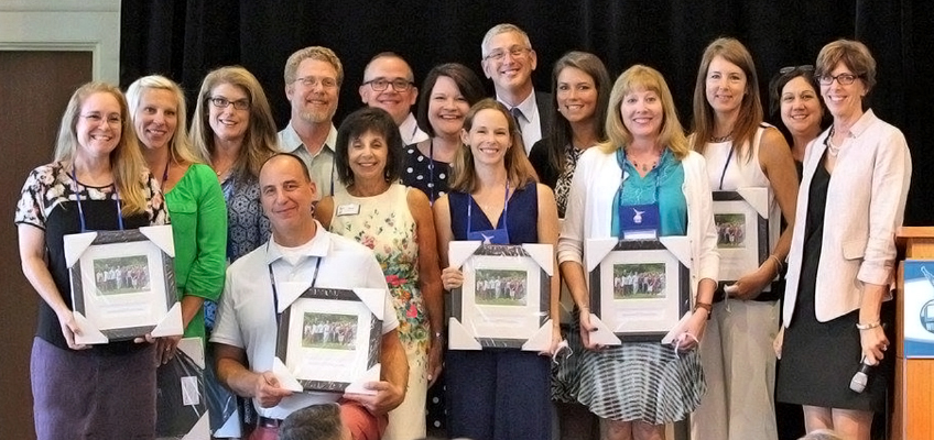 Barbara and Ed Wilson with new Credentialed Wilson Trainers during the 2016 conference.