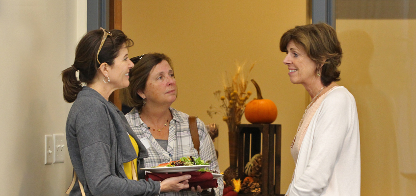 Barbara Wilson speaks with attendees during Parent Night.