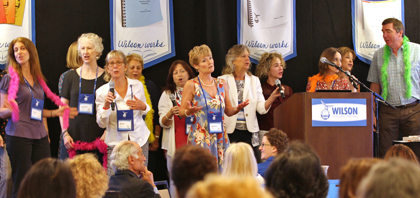 Wilson Literacy Specialists and Trainers singing at annual Trainer meeting in July 2017