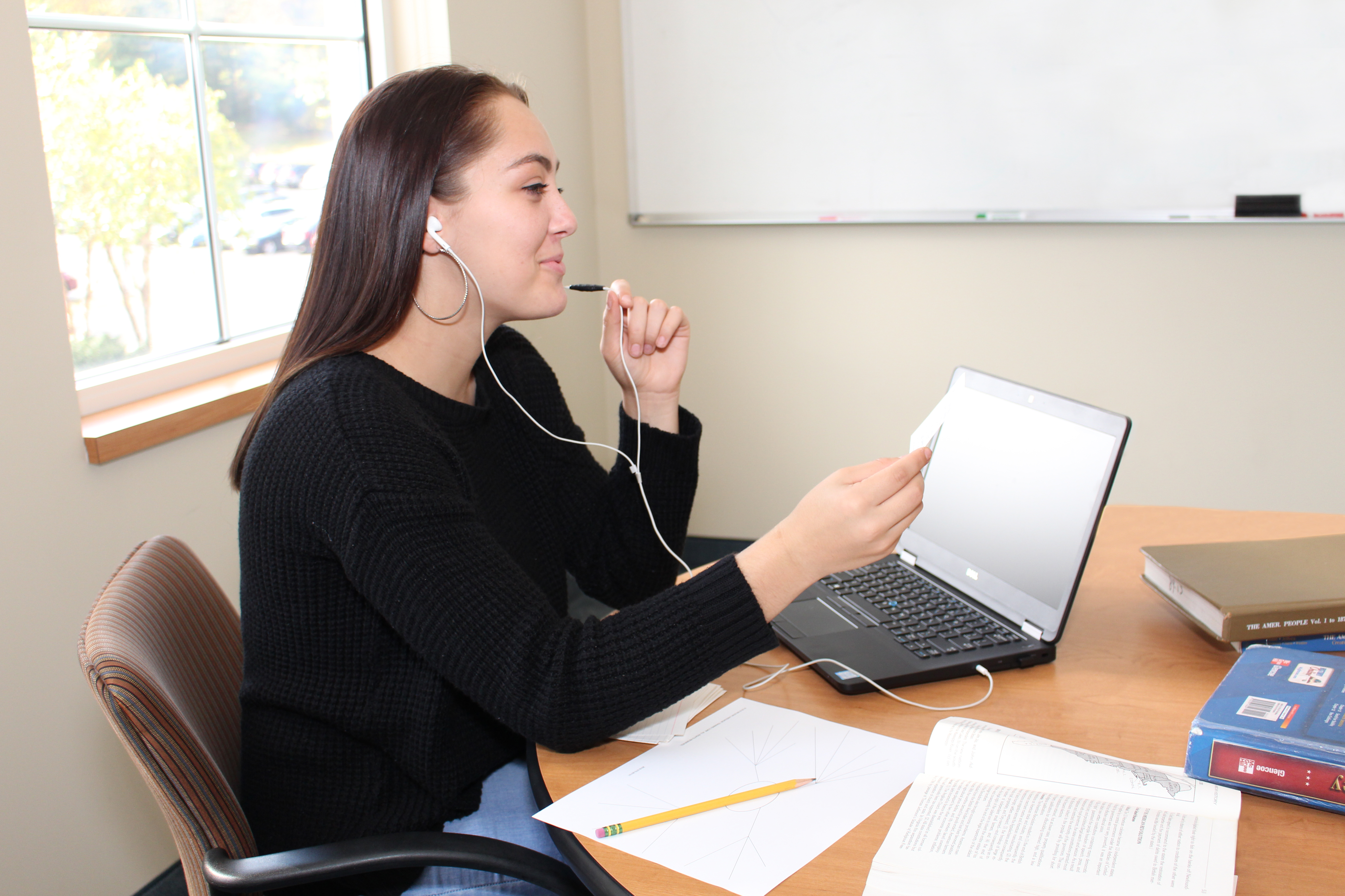 Female student learning remotely